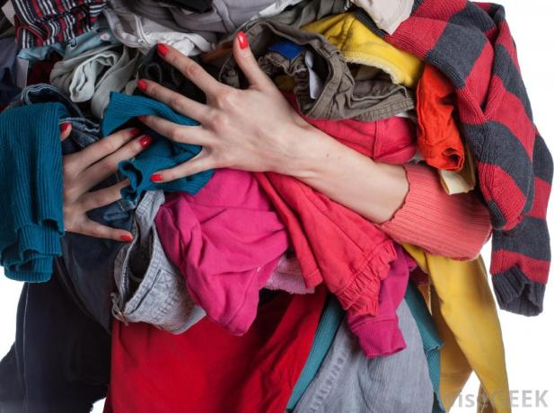 womans-arms-full-of-clothes